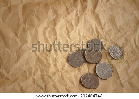 Thailand baht coins on background of light brown. - stock photo