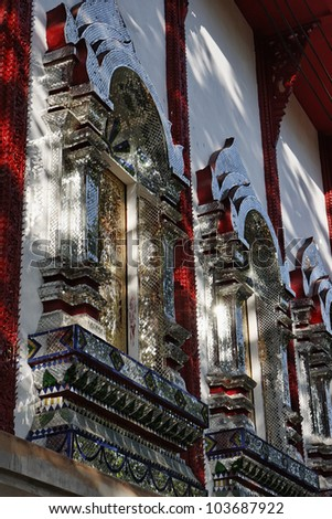 Thailand, Bangkok, Imperial city, shiny mirror ornamental tiles on the windows of a Buddhist temple