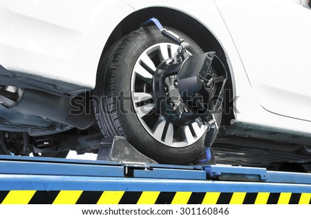 Thailand, Bangkok - July 27, 2015: Closed up of an auto wheel that is undergoing wheel alignment on July 27, 2015. - stock photo