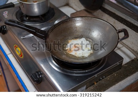 THAILAND BANGKOK 21 SEPTEMBER 2015: Fried egg in a frying pan Thai style to making breakfast.On 21 September 2015,Bangkok Thailand