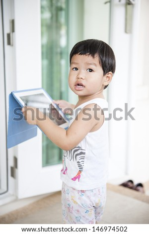 Thailand boy (Asian boy) playing tablet - stock photo