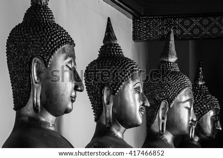 Thailand buddha statues close up in perspective.