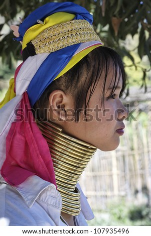 Thailand, Chiang Mai, Karen Long Neck hill tribe village (Baan Tong Lhoung), Long Neck woman in traditional costumes. Women put brass rings on their neck when they are 5 or 6 years old - stock photo