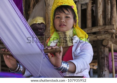 Thailand, Chiang Mai, Karen Long Neck hill tribe village (Baan Tong Lhoung), Long Neck woman in traditional costumes. Women put brass rings on their neck when they are 5 or 6 years old