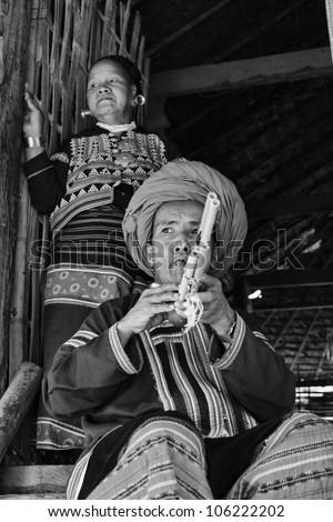 Thailand, Chiang Mai, Karen Long Neck hill tribe village (Kayan Lahwi), Karen couple in traditional costumes - stock photo