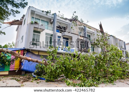 THAILAND, CHIANG MAI - MAY 17: Damage building and cars by falling trees after hard rain storm in Sarapee of Chiang Mai, Thailand on May 17, 2016.