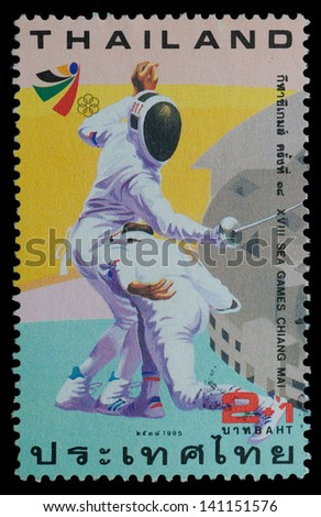 THAILAND - CIRCA 1995: A postage printed in Thailand show image of fencing from XVIII SEA GAMES CHIANG MAI Commemorative Stamps , circa 1995