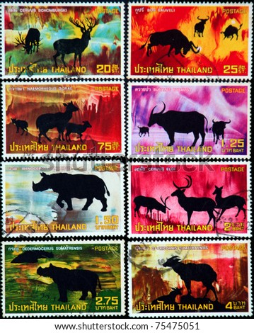 """THAILAND - CIRCA 1973: A series of postage stamps printed in Thailand shows silhouette image of rare endangered wildlife, from the series """"Protected Wild Animals, 1st Series"""", circa 1973 - stock photo"""