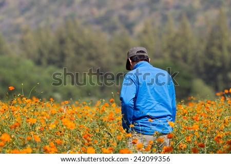 THAILAND - DECEMBER 29 : man Traveling to flower park at Jim Thompson garden in Nakornrajsima, Thailand on December 29th, 2014 - stock photo