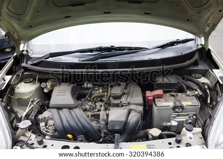 Thailand Eco Car 1600cc  with dirty open hood show parts in side. - stock photo