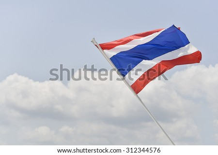 Thailand flag on boat with blue sky.