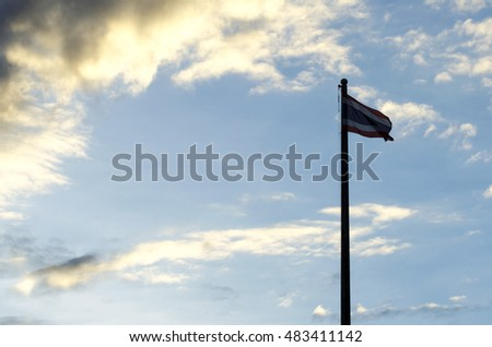 Thailand flag pole silhouette at sunset, Rain is coming