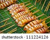 Thailand food - barbecue from squids sold on the street asian market - stock photo