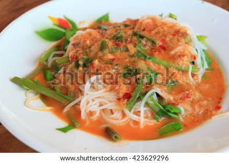 Thailand food noodles topped with sauce made from chili sauce mixed with fish and fish
