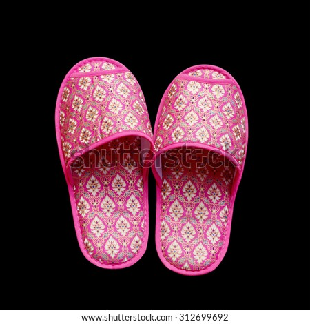 Thailand handmade cloth slippers isolated on black background. This has clipping path.