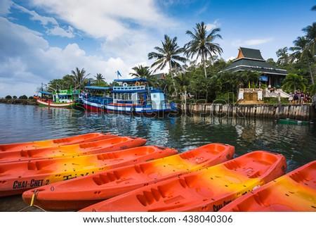 THAILAND, KO CHANG- APRIL 1, 2015 : Thailand tropical island of Koh Chang. Fishing boat and kayak in Ko Chang, Thailand. - stock photo