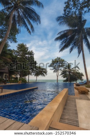 Thailand. Ko Chang. December 11, 2011.Chang Buri Resort hotel swimming pool with sea views.