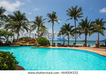 Thailand, March 31, 2015. Pool and palms on sea shore. Thailand, Koh Chang, Klong Prao beach