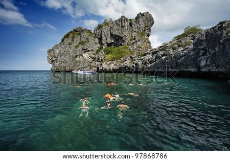 Thailand, MU KOH ANGTHONG National Marine Park, snorkelers swim in the clear water - stock photo