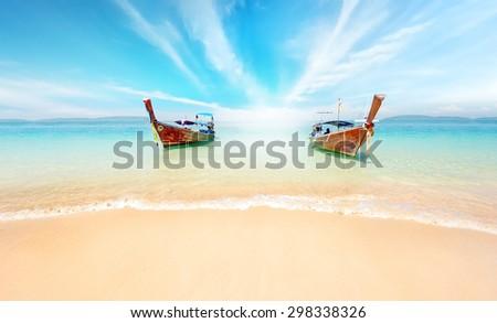 Thailand nature landscape. Sandy beach and travel boats on coast of tropical island near Phuket - stock photo
