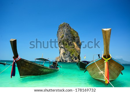 Thailand ocean landscape with traditional long tail boat  - stock photo