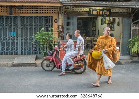 Thailand 2015 Oct 18, Buddhist monk and people who giving food offering to a monk  at Tha-laung community,Chantaburi town Thailand
