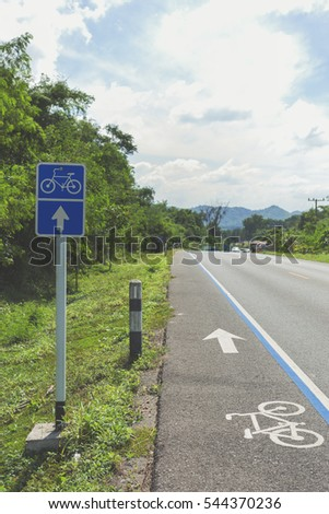 Thailand of bicycles road. Bicycle sign path on road. Bikes lane paint in blue.