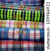 Thailand original cotton fabric pattern in bundle with natural thread layer in a heap - stock photo