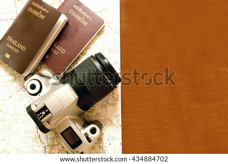 Thailand passport and camera on the map for World travel and travel asia ,vintage tone - stock photo