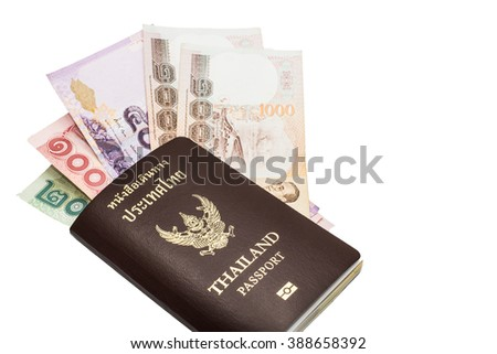 Thailand passport and Thai money on white background.