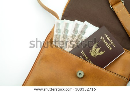 Thailand passport in travel bag.