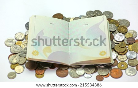Thailand passport on international coin - stock photo