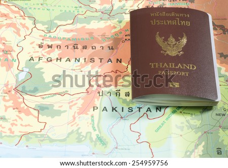 Thailand Passports on a map of the Afghanistan and Pakistan. - stock photo