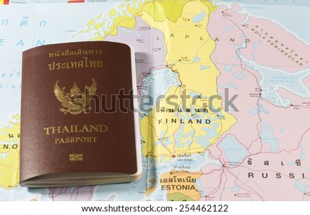 Thailand Passports on a map of the Finland, Estonia and Russia. - stock photo