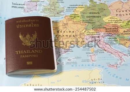 Thailand Passports on a map of the France, Andorra,Germany and Italy . - stock photo