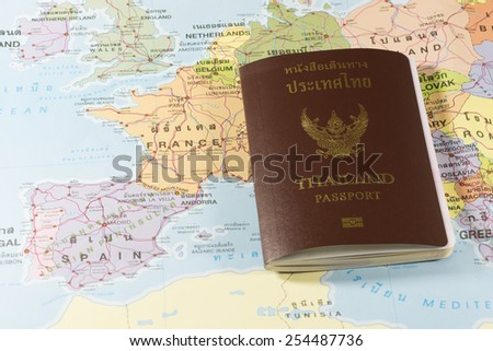 Thailand Passports on a map of the France, Spain,Andorra  and Portugal. - stock photo