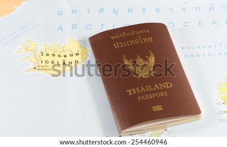 Thailand Passports on a map of the Iceland. - stock photo