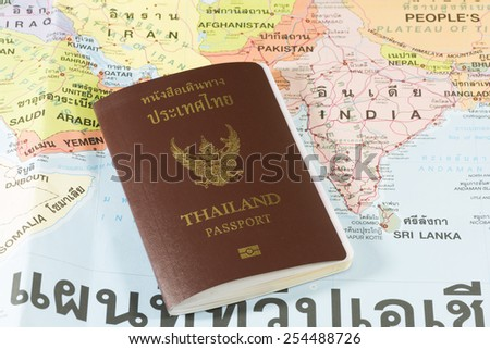 Thailand Passports on a map of the India, Pakistan,Nepal and Sri Lanka. - stock photo