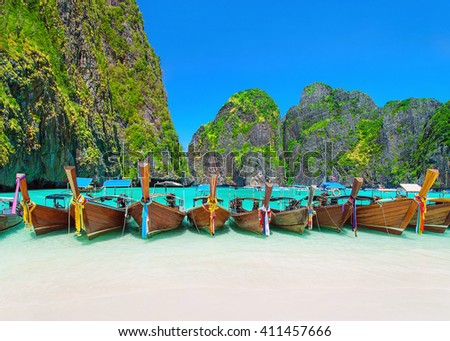 Thailand scenic beach view at ring of steep limestone hills with many traditional longtail taxi boats mooring, Maya Bay, Ko Phi Phi Lee island, Phi Phi archipelago, part of Krabi Province, Andaman Sea - stock photo