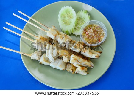 Thailand street food stir-fried squid eggs serve with seafood sauce. - stock photo