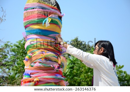 Thailand traditional and culture Thai women tie the fabric in three colors Chiangrai City Pillar Shrine or Sadu Mueang at Doi Chom Thong - stock photo