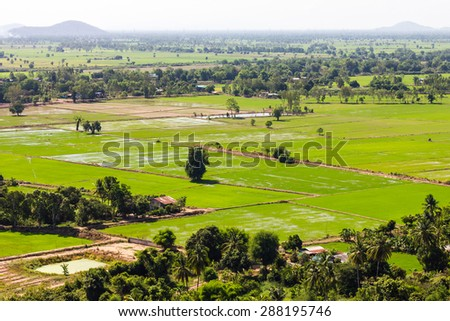 Thailand views above the road cut through the rural landscape where farming is the main occupation. - stock photo