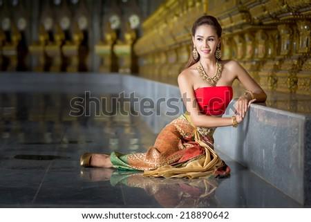 Thailand women beautiful vintage dress sitting  - stock photo