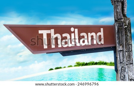 Thailand wooden sign with a beach on background - stock photo