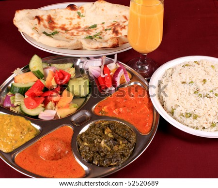 thali an indian bread a curry combo served with roti or naan and salad - stock photo