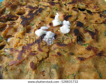 Thalipeeth is a type of savoury multi-grain pancake popular in Western India. It is a special Maharashtrian dish.