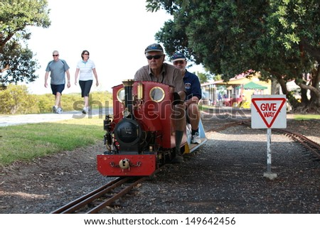 THAMES - MAY 19: Train driver taking locals and tourists for rides at the Thames Small Gauge Railway annual open day on May 19, 2013 in Thames, New Zealand. - stock photo