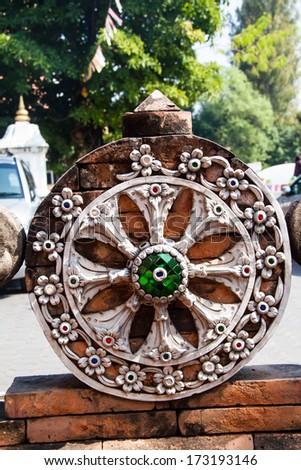 Thammachak; rowel Symbols of Buddhism in Thai temples. - stock photo