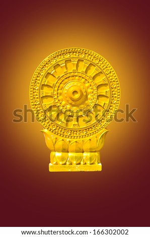 thammachak symbol in Buddha in Thai temple on yellow light - stock photo