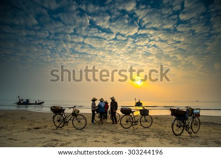 THANH HOA, VIETNAM - DEC 20, 2014: Small fish market on beach in sunrise. Traditional fish market happen only in early morning.